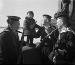 Soviet Baltic Fleet sailors with orphan Lucy, Leningrad, Russia, May 1943