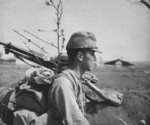 Japanese Army soldier carrying a Type 11 machine gun, date unknown