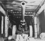 Japanese 15cm cannon in a cave at Motobu Peninsula, Okinawa, Japan, 1945