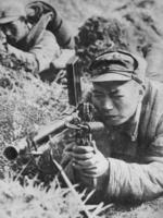 Chinese soldier of the Japanese-sponsored Nanjing puppet government with a ZB vz. 26 light machine gun, China, date unknown