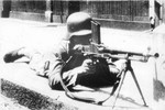 Chinese soldier with a ZB vz. 26 light machine gun in an urban street, date unknown
