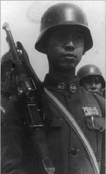 Chinese soldier with Czech-made ZB vz. 26 light machine gun and German-style helmet, date unknown